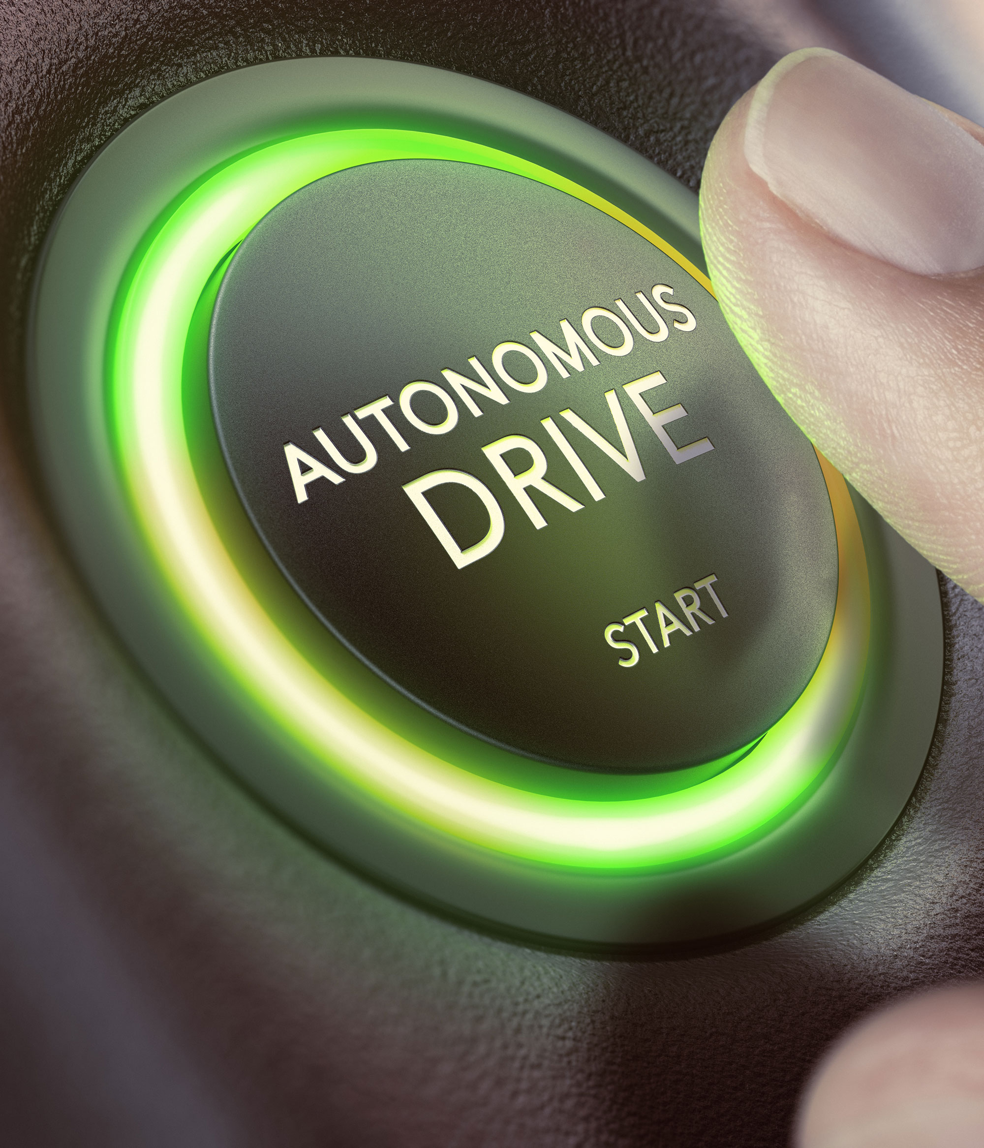 Finger pressing a push button to start a self-driving car.